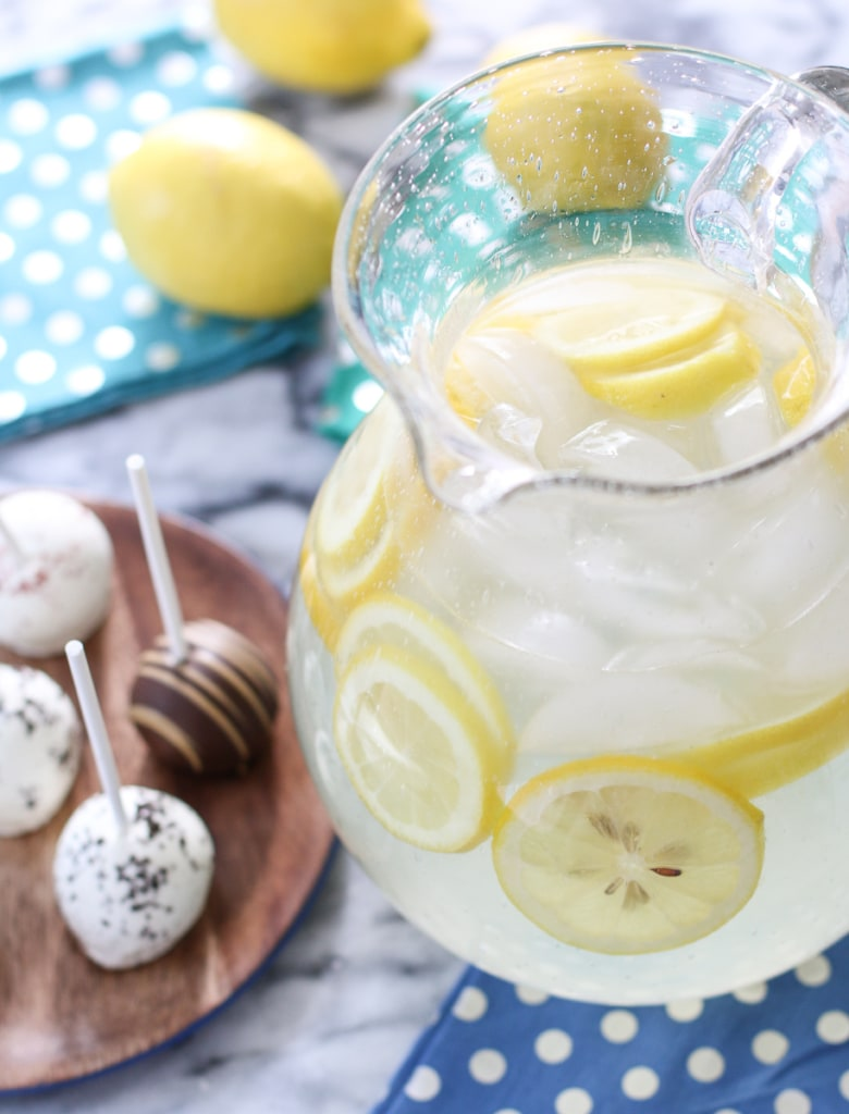 Cake pops and pitcher of old-fashioned lemonade